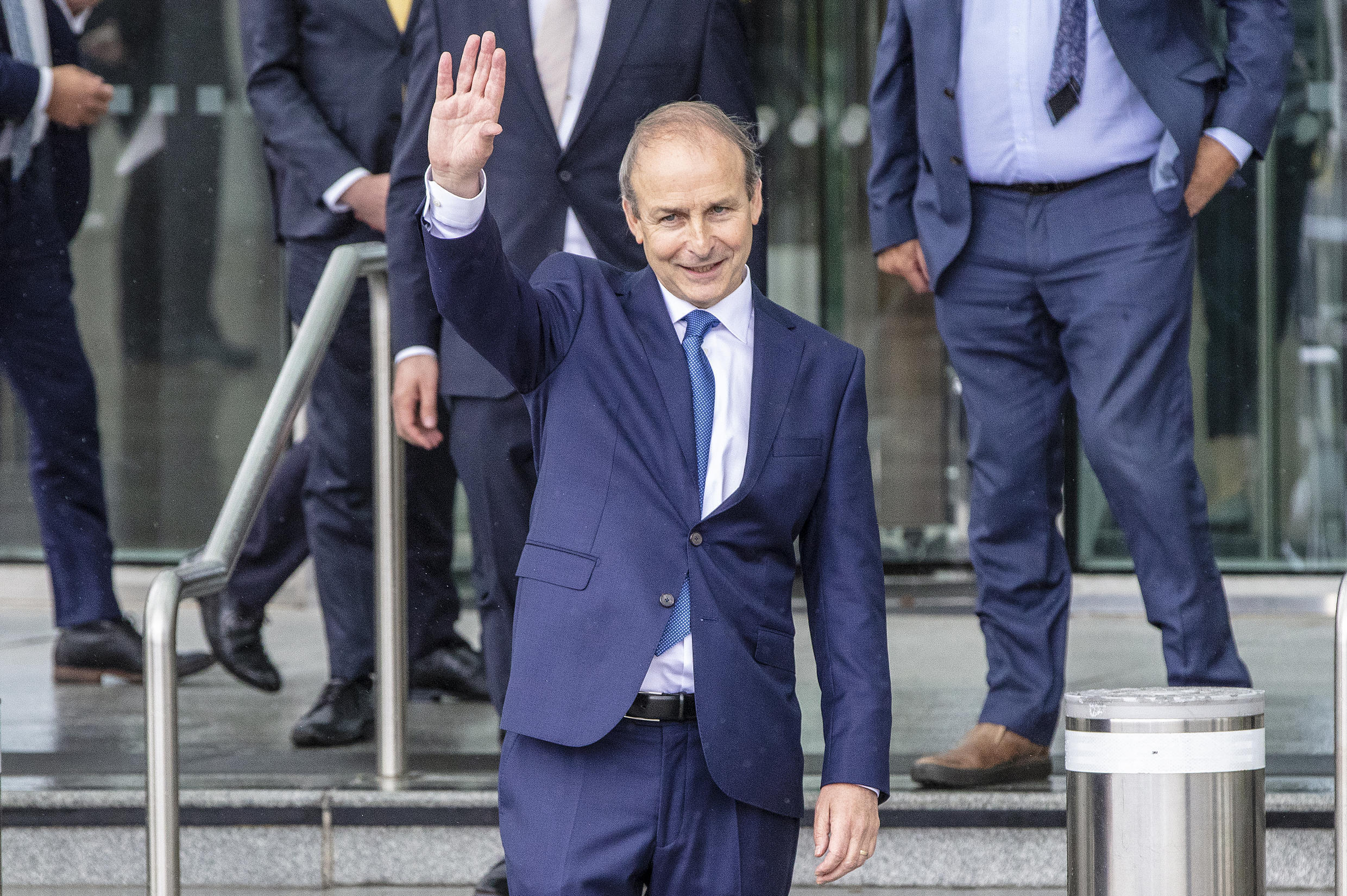 Fianna Fail leader Micheal Martin waves after being elected Ireland's new prime minister
