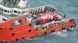A handout photo shows parts of the AirAsia wreckage that has been retrieved from the Java Sea