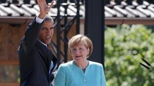 الرئيس الأمريكي باراك أوباما مع المستشارة الألمانية أنغيلا ميركل