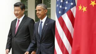 - الرئيسين الأمريكي باراك أوباما والصيني شي جينبينغ بالبيت الأبيض في 25 أيلول/سبتمبر 2015
