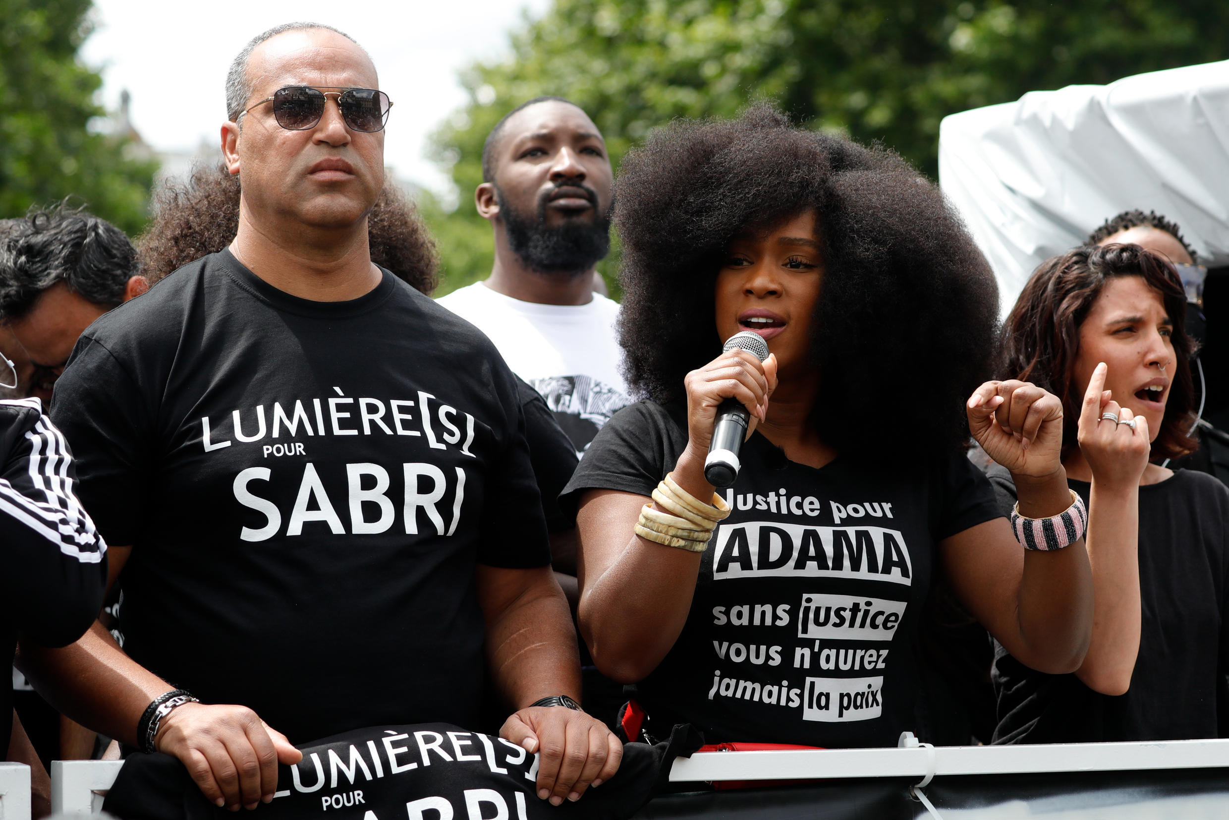 Assa Traore (C), the sister of Adama Traore, who died in police custody in 2016 speaks at rally in Paris's Place de la Republique as part of the worldwide Black Lives Matter movement against racism and police brutality, June 13, 2020.