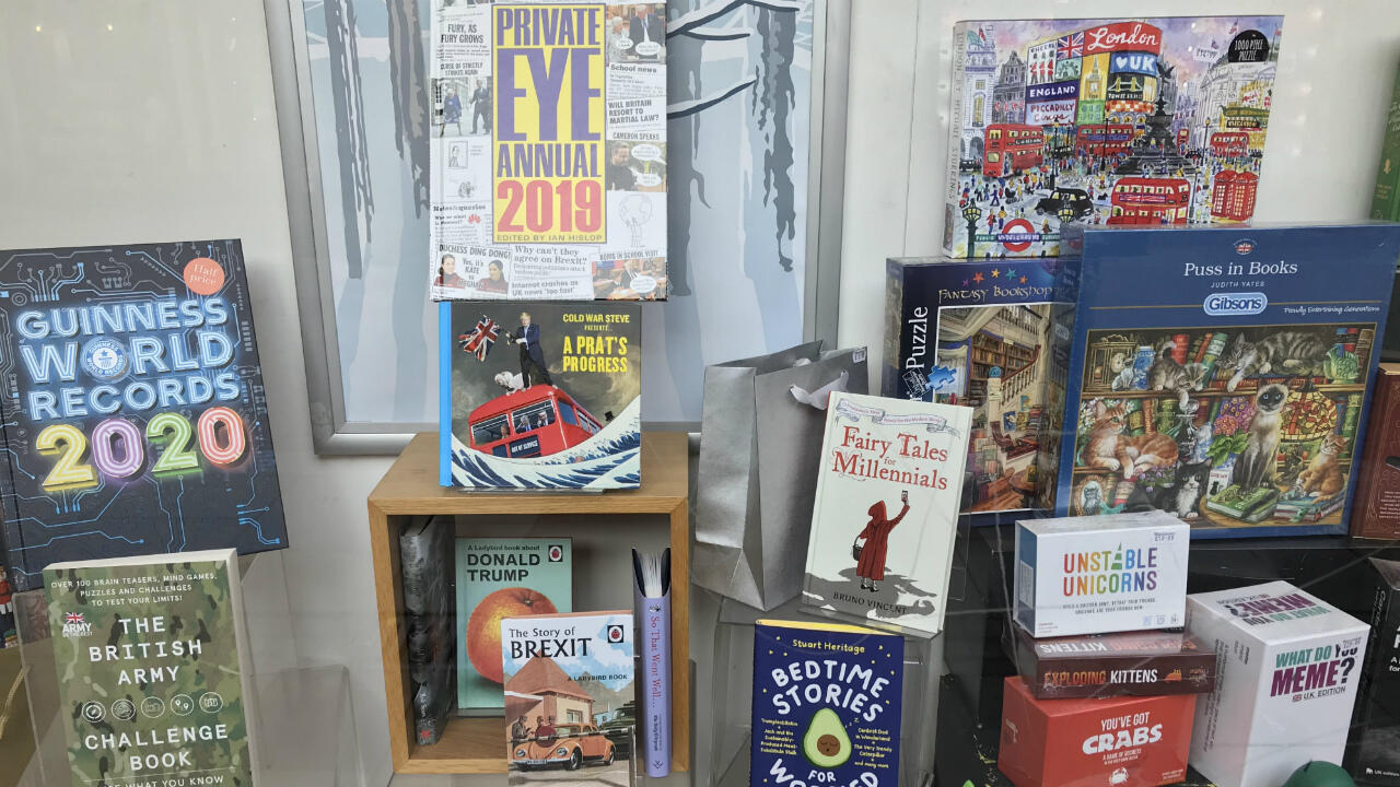 "Satirical books on display in an Uxbridge bookshop, reflecting readers' desire for ""escapism"" amid Britain's tumultuous politics, according to a member of staff there."