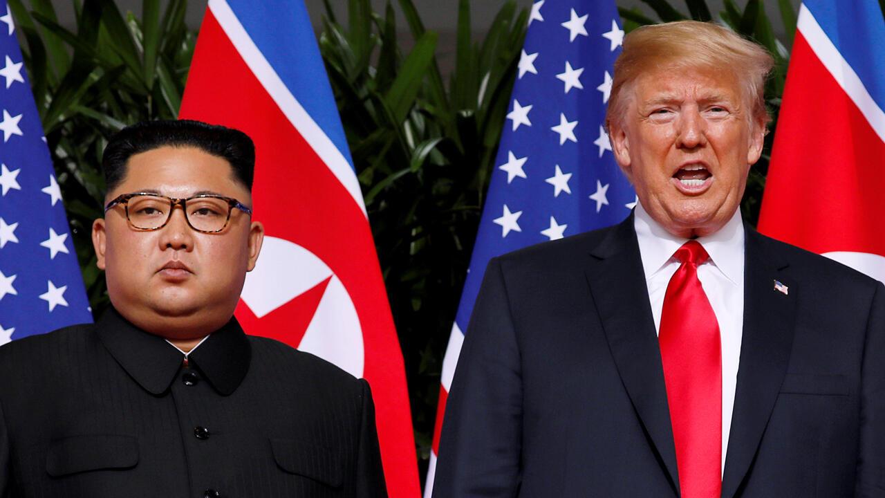Archivo: el presidente de Estados Unidos, Donald Trump, y el líder norcoreano, Kim Jong-un, reaccionan en el Hotel Capella, en la isla Sentosa, en Singapur el 12 de junio de 2018.