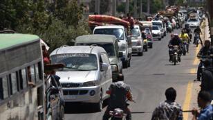 Des déplacés syriens de la province de Deraa, de retour dans leur ville de Bosra, le 11 juillet 2018.