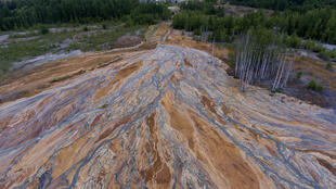 Drone footage uploaded last week by an Instagram travel blogger showed a bright-orange landscape near the disused copper-sulphide mine