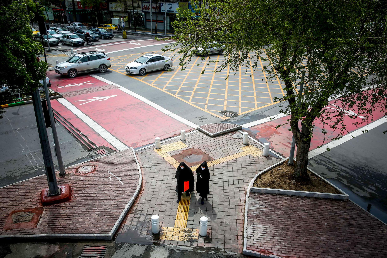 Iranian women walk in April 2020 in the northeastern city of Mashhad, where US Navy veteran Michael White had been held