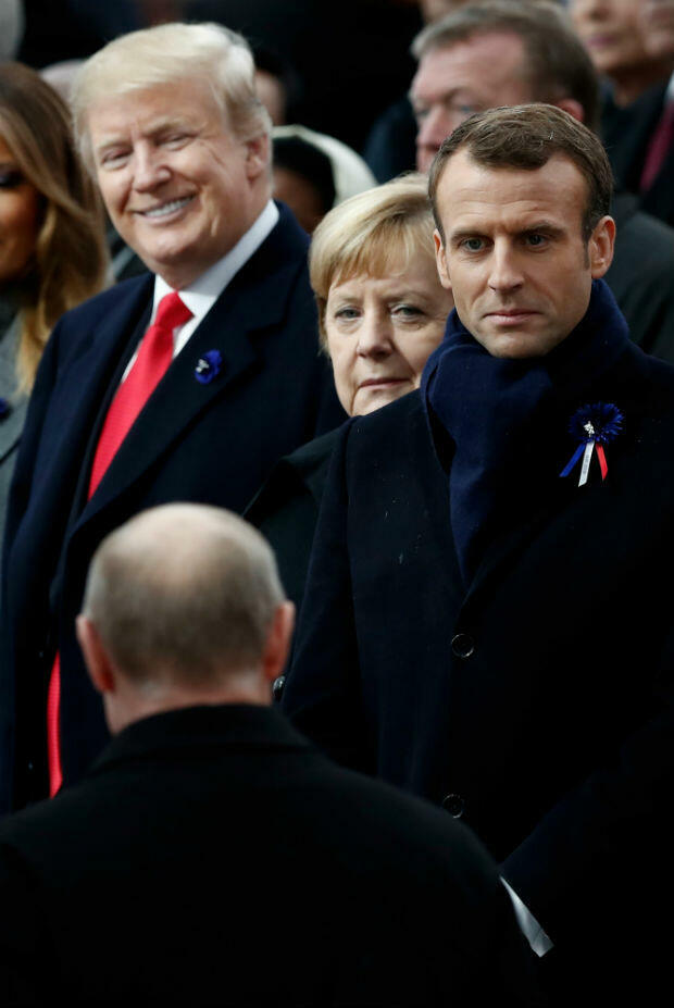 US President Donald Trump, German Chancellor Angela Merkel and French President Emmanuel Macron watch as Russian President Vladimir Putin arrives at a ceremony at the Arc de Triomphe in Paris on November 11 as part of commemorations marking the WWI Armistice.