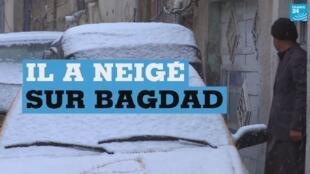 Une rue de Bagdad recouverte par une fine couche de neige, le mardi 11 février.