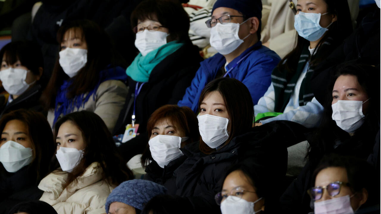 Spectators wearing masks to prevent contacting to a new coronavirus attend Four Continents Figure Skating Championships 2020 in Seoul, South Korea, February 7, 2020.