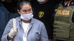 Peruvian politician Keiko Fujimori wears a face mask -against the spread of the COVID-19 coronavirus- while leaving Santa Monica jail in Lima on May 04, 2020