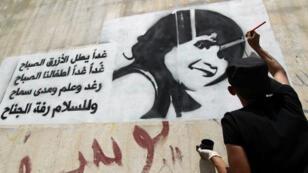 Dessin sur un mur de Sanaa dénonçant l'exploitation des enfants dans la guerre civile qui frappe le Yémen.