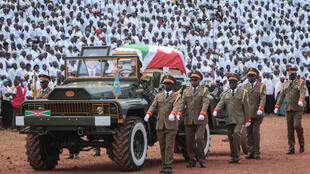 Pierre Nkurunziza's coffin, draped in the country's national flag, is presented on a ceremonial vehicle at the Ingoma stadium in Gitega, Burundi, on June 26, 2020.