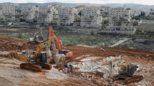 Construction de colonies israéliennes en Cisjordanie occupée à Beitar Illit le 14 février 2018. Les colonies israéliennes dans les territoires palestiniens occupés sont considérées comme illégales au regard du droit international