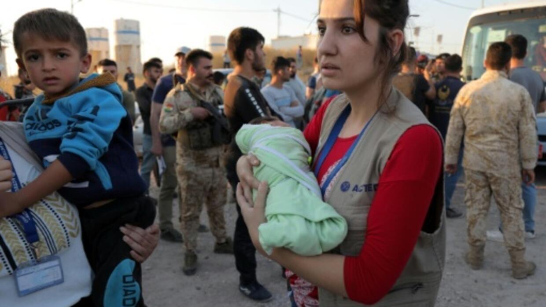 Syria Kurd families flee to Iraq as array of armies advance