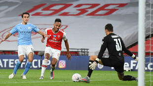 Arsenal forward Pierre-Emerick Aubameyang (C) scores his second goal in a stunning 2-0 FA Cup semi-final triumph over Manchester City at Wembley