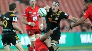 Back after eight weeks: Waikato Chiefs' Brodie Retallick (centre), seen here offloading in a tackle against Japan's Sunwolves in March