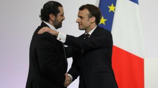 Saad Hariri et Emmanuel Macron lors de la conference des donateurs, à Paris, le 6 avril 2018.
