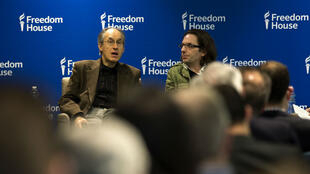 Charlie Hebdo's editor-in-chief, Gerard Biard (L) speaks as film critic, Jean-Baptiste Thoret, looks on at the Freedom House in Washington, DC, on May 1, 2015