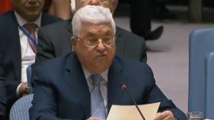 الرئيس الفلسطيني محمود عباس أمام مجلس الأمن الدولي، في شباط/فبراير الماضي.