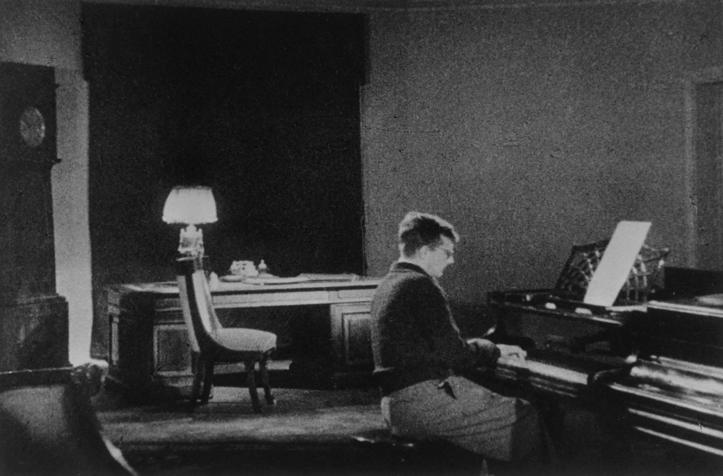 A Soviet press release of Russian composer Dmitri Shostakovich composing his 7th Symphony during the siege of Leningrad.