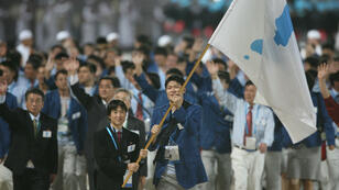 Le drapeau commun des deux Corées lors des Jeux asiatiques de 2006 à Doha, au Qatar.
