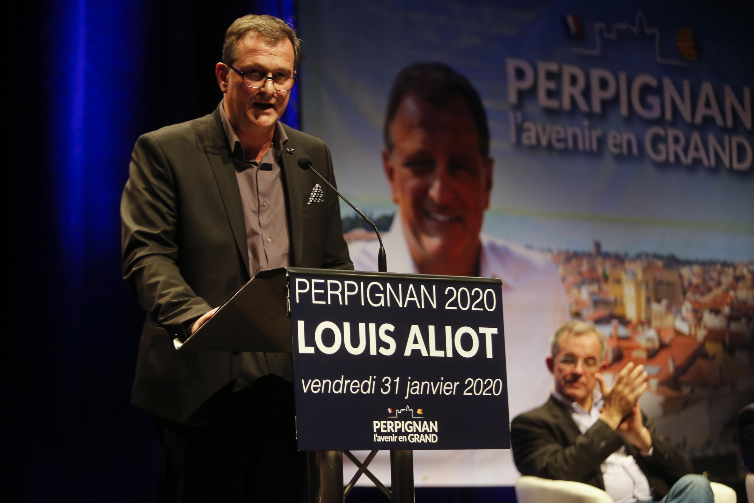 L In this file photo taken on January 31, 2020 French far-right party Rassemblement National (RN) MP and candidate for the upcoming mayoral elections Louis Aliot speaks on stage during a meeting in Perpignan on January 31, 2020.