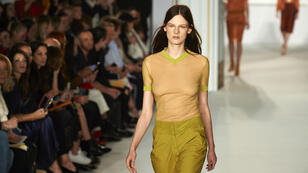 Models present creations by British designer Jasper Conran during a show held during The London Fashion Week Women's on September 16, 2017.