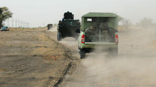 Des soldats nigérians patrouillant le nord de l'État de Borno, le 5 juin 2013.