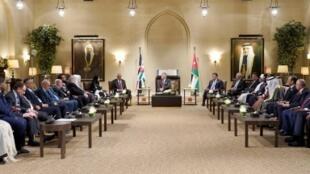 King Abdullah II of Jordan (C) hosts the conference of Arab parliaments in Amman