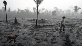 Brazilian farmer Helio Lombardo Do Santos walks through a burned area of the Amazon rainforest near Porto Velho, Rondonia state on August 26, 2019
