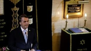 President-elect Jair Bolsonaro, pictured speaking in a synagogue, has promised to be a leader for all of Brazil but there is no sign yet of a unifying agenda