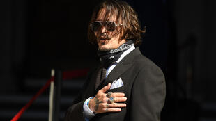 Johnny Depp said the headline in The Sun tabloid altered his Hollywood image and endangered his career