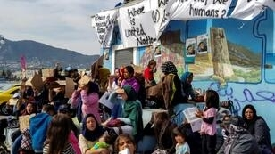 A protest by migrants on Lesbos in April. The conditions they live in are reaching crisis proportions according to a UN official
