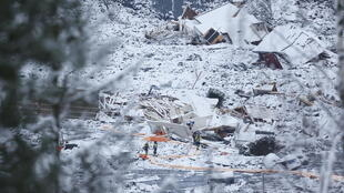Rescue crews work in the area at Ask in Gjerdrum, on January 2, 2021, after a massive landslide smashed into a residential area near the Norwegian capital on Wednesday.
