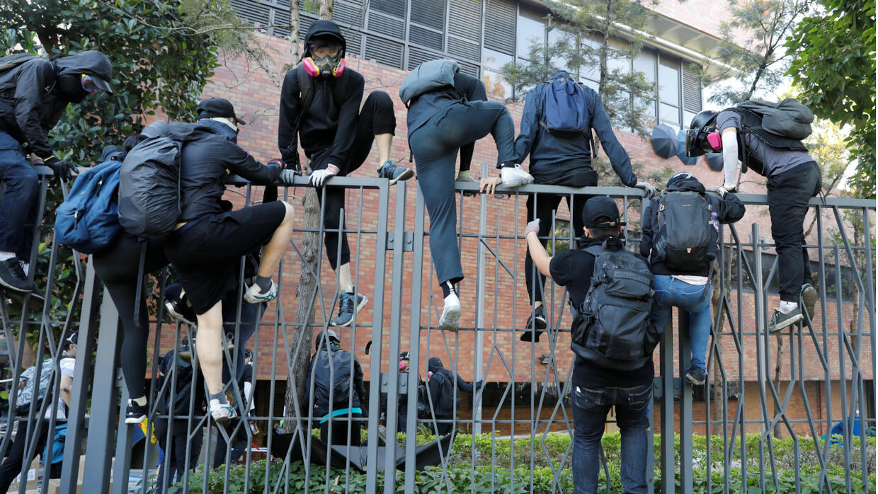 Hong Kong police warn of 'live fire' as stand-off at university continues