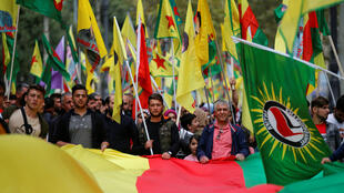 Kurdish protesters attend a demonstration against Turkey's military action in northeastern Syria, in Marseille, France, October 12, 2019.