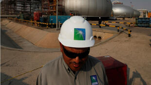 File photo of an Aramco employee in a branded helmet at Saudi Aramco oil facility in Abqaiq.