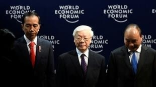 Vietnam's Communist Party General Secretary Nguyen Phu Trong (C), flanked by Indonesia's President Joko Widodo (L) and Vietnam's Prime Minister Nguyen Xuan Phuc (R), pictured at the World Economic Forum in Hanoi on September 12, 2018