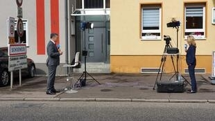 FRANCE 24's François Picard and Deutsche Welle's Melinda Crane on either side of the Franco-German border.