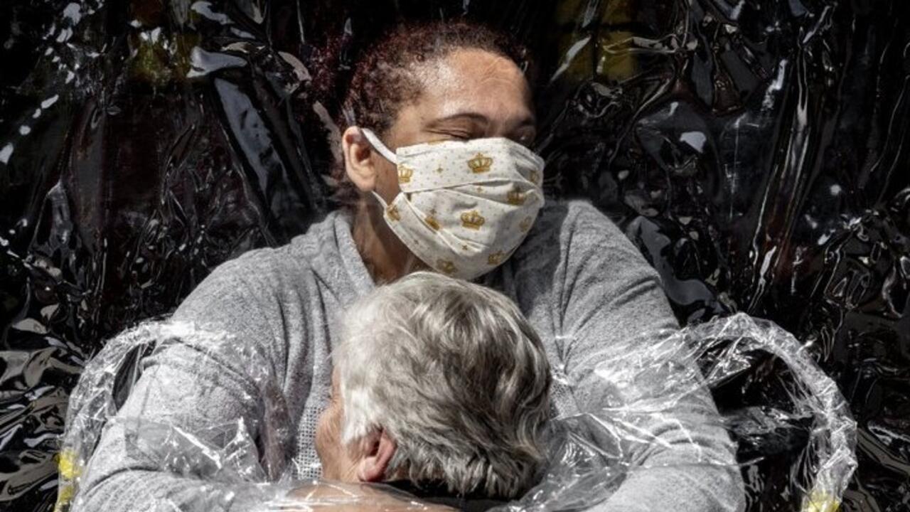 Picture of coronavirus hug named World Press Photo of the Year