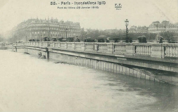 A postcard from the 1910 Great Flood of Paris shows passersby on the Pont de l'Alma near the Eiffel Tower