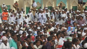 Supporters of Sudanese President Omar al-Bashir attend a rally ahead of presidential and parliamentary elections being held from April 13-15