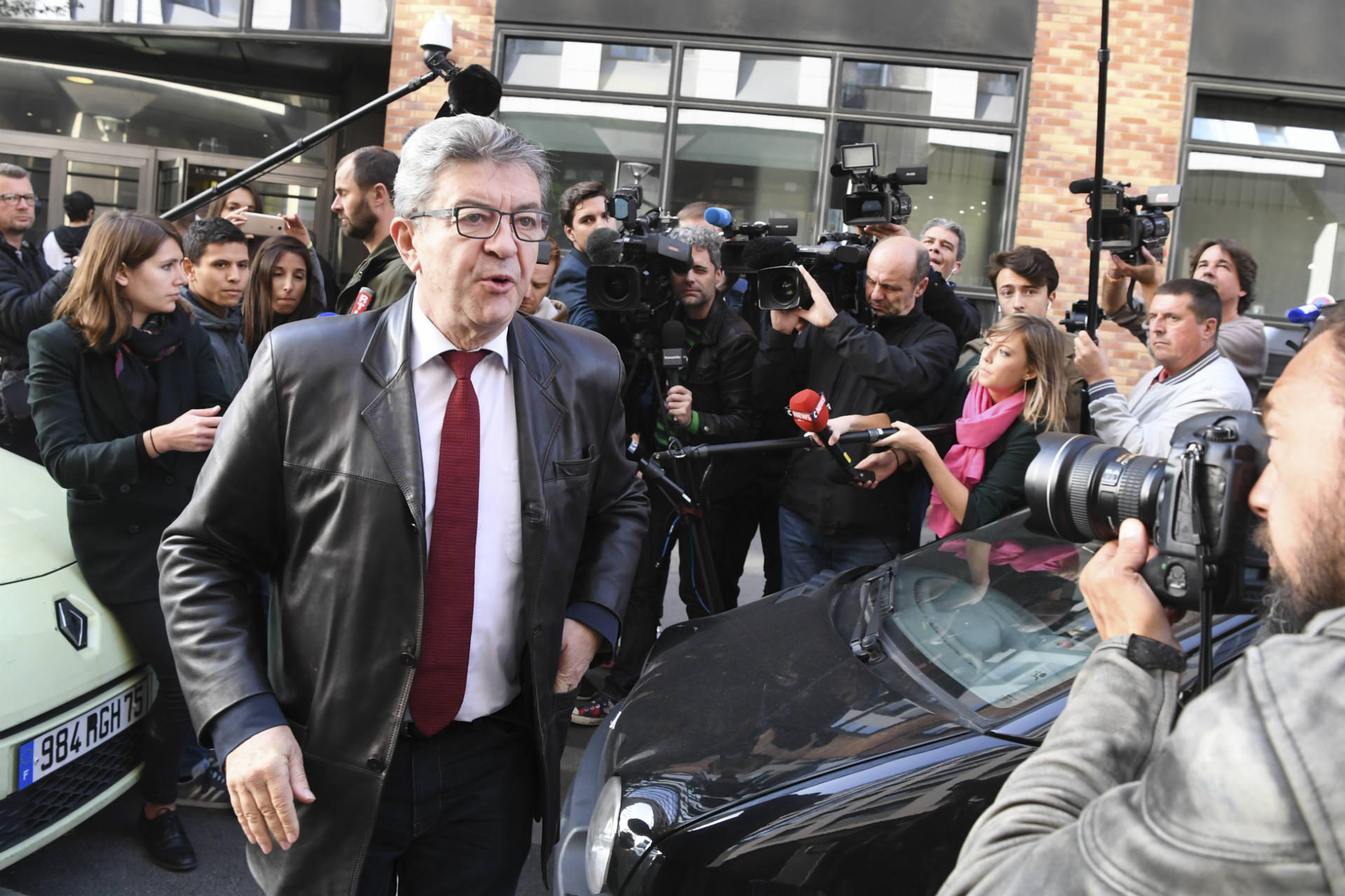 """Anti-corruption investigators raided the home and party headquarters of Jean-Luc Mélenchon, founder of far-left party France Unbowed, in October as part of twin enquiries into the misuse of European Parliament funds and funding irregularities during Mélenchon's 2017 presidential campaign. The left-wing leader physically resisted the police officers, pronouncing himself at once a victim and a sacred figure. """"I am the Republic,"""" he proclaimed, repeatedly asking the officers, """"Do you know who I am?"""" He and others at the office blocked the anti-corruption investigators, forcing them to leave without completing their inspection. Mélenchon tried to paint the raid as a political hit, but public opinion did not fall in his favour."""