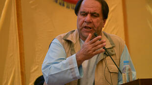Fugitive former Afghan football chief Keramuddin Karim speaks during his first public appearance in about two years in the village of Malaspa on September 4, 2020