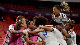 Lyon's players celebrate after scoring a goal during the UEFA Women's Champions League semi-final football match between Paris Saint-Germain and Lyon at the San Mames stadium in Bilbao on August 26, 2020.