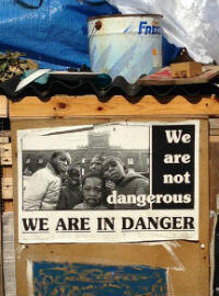 """A poster at the sprawling camps known as the """"Calais Jungle"""", where migrants live while attempting to enter the UK. (Photo: Ferdinande van Tets)"""