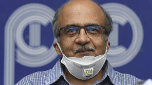 Prashant Bhushan smiles during a press conference in New Delhi after being fined a token one rupee (one US cent) for contempt of court