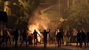 صدامات بين محتجين وقوات الأمن التونسية في مدينة سليانة في 11 كانون الثاني/يناير 2018.