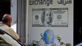 A man stands outside a currency exchange office in the Lebanese capital Beirut