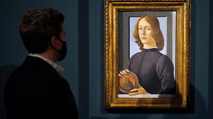 "Sold for $92 million -- Sandro Botticelli's ""Young Man Holding a Roundel"" pictured at Sotheby's in New York City"